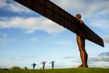young people at the Angel of the North
