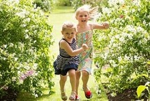 two children running in a garden