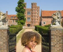 Little girl in front of a castle