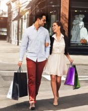 Young couple shopping in a high street holding shopping bags