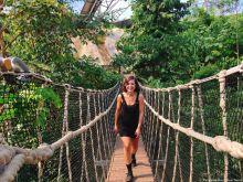 girl_walking_across_bridge