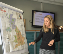 Staff training presentation with VisitBritain branded map of Britain on a flip chart