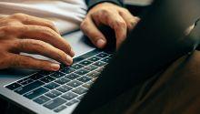 hands typing on a laptop hands typing on a laptop