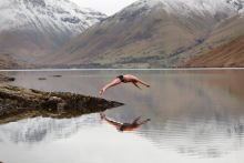 man diving into a lake