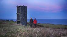 Couple walking on the Durham Heritage Coast at Easington Colliery, County Durham, England.