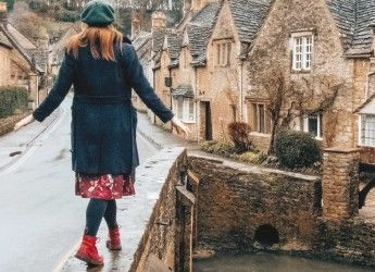girl walking on a bridge in a Cotswolds village