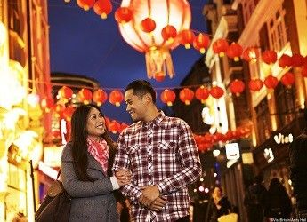 a young couple enjoying a night in China town