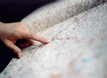 Finger pointing to map