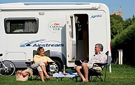 A couple outside their caravan