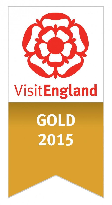 Gold accolade logo