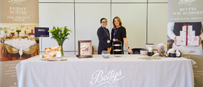 Two women from Bettys stood marketing at ExploreGB 2019