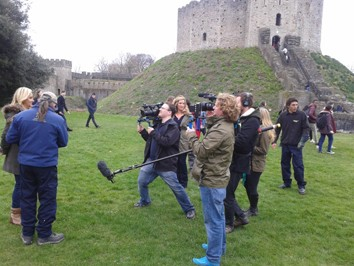 Broadcast journalists filming a segment on location in Wales